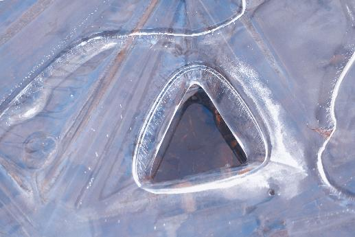 Triangle Hole in Ice